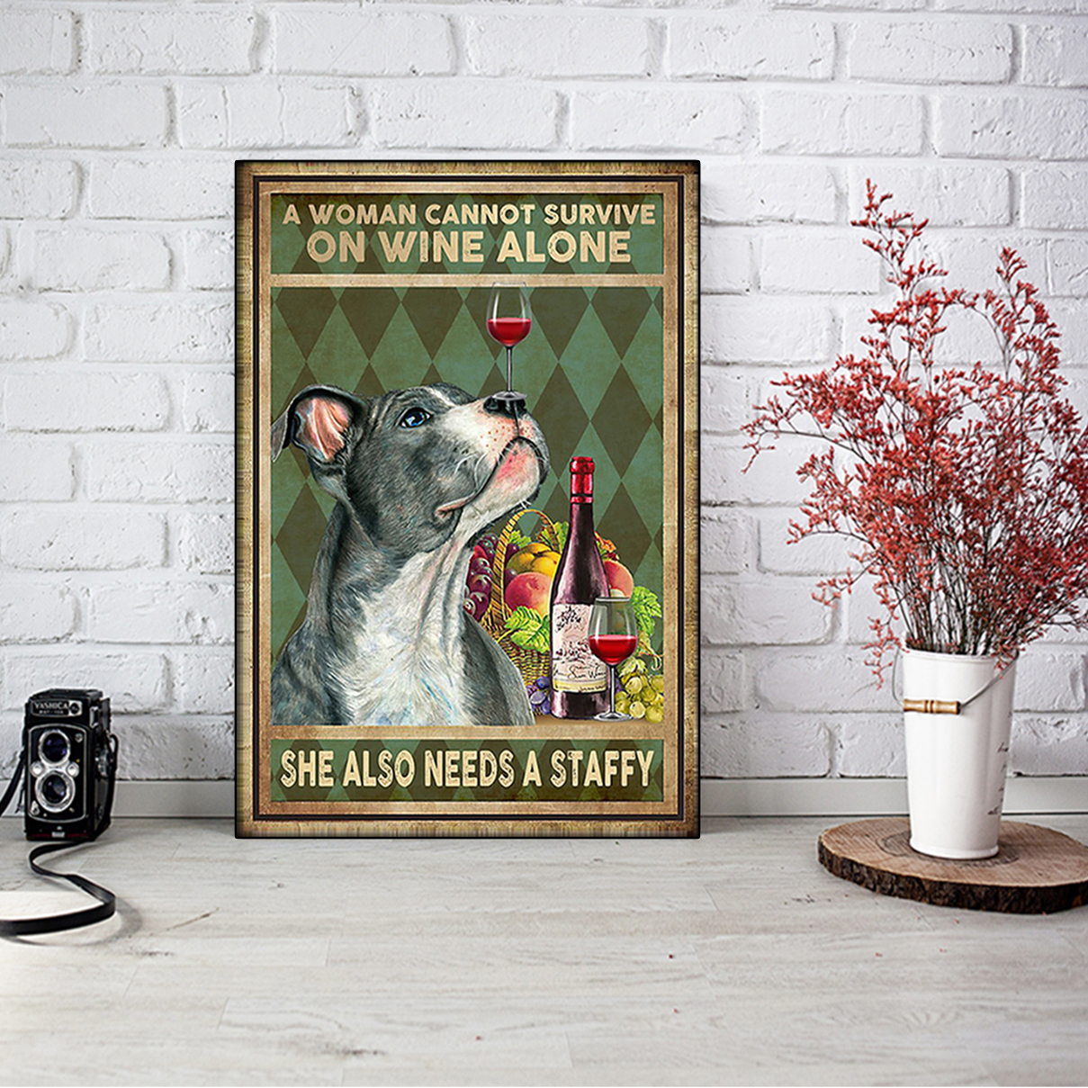 A woman cannot survive on wine alone she also needs a staffy poster A2