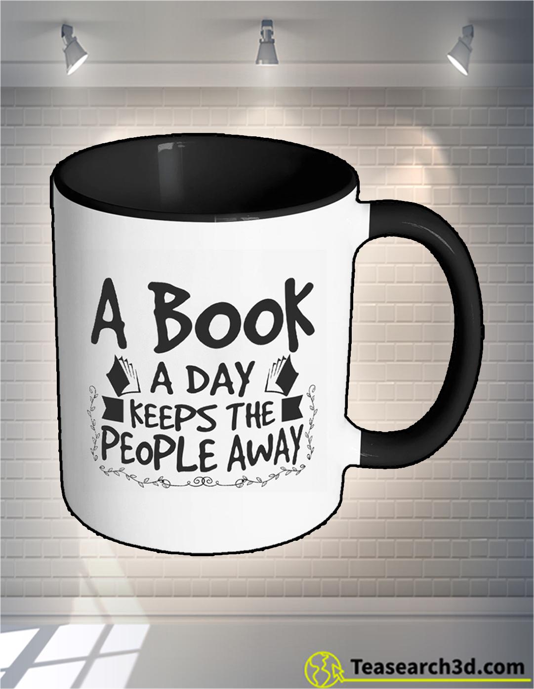 A book a day keeps the people away mug 15oz